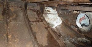 Concrete repairs on steel hull.